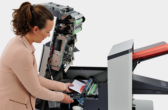 Person using Neopost DS-64i Folder Inserter